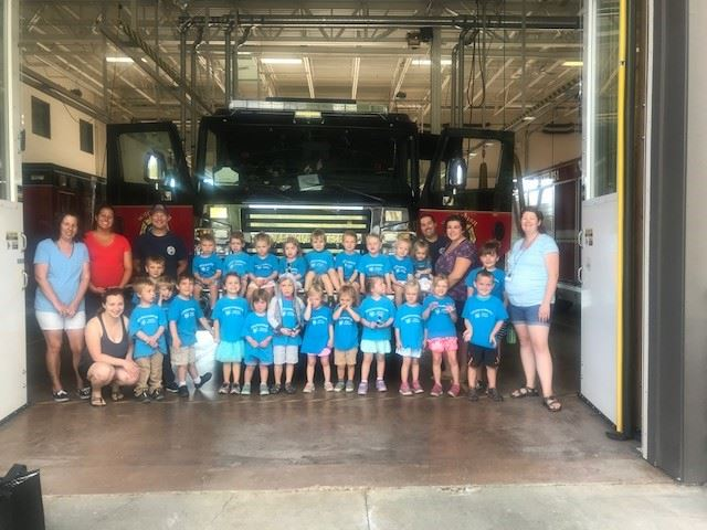 Growing in Gods Love Preschool Group Photo in Front of a Fire Truck
