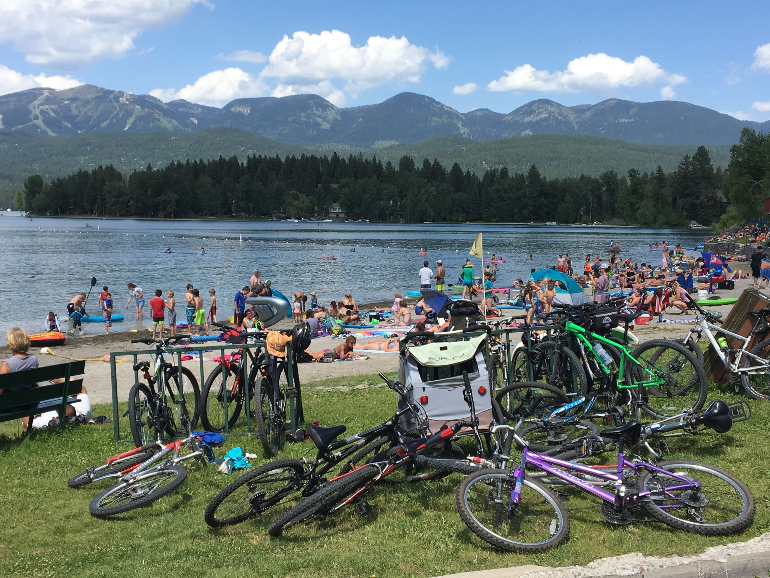 Lake with bikes on shoreline